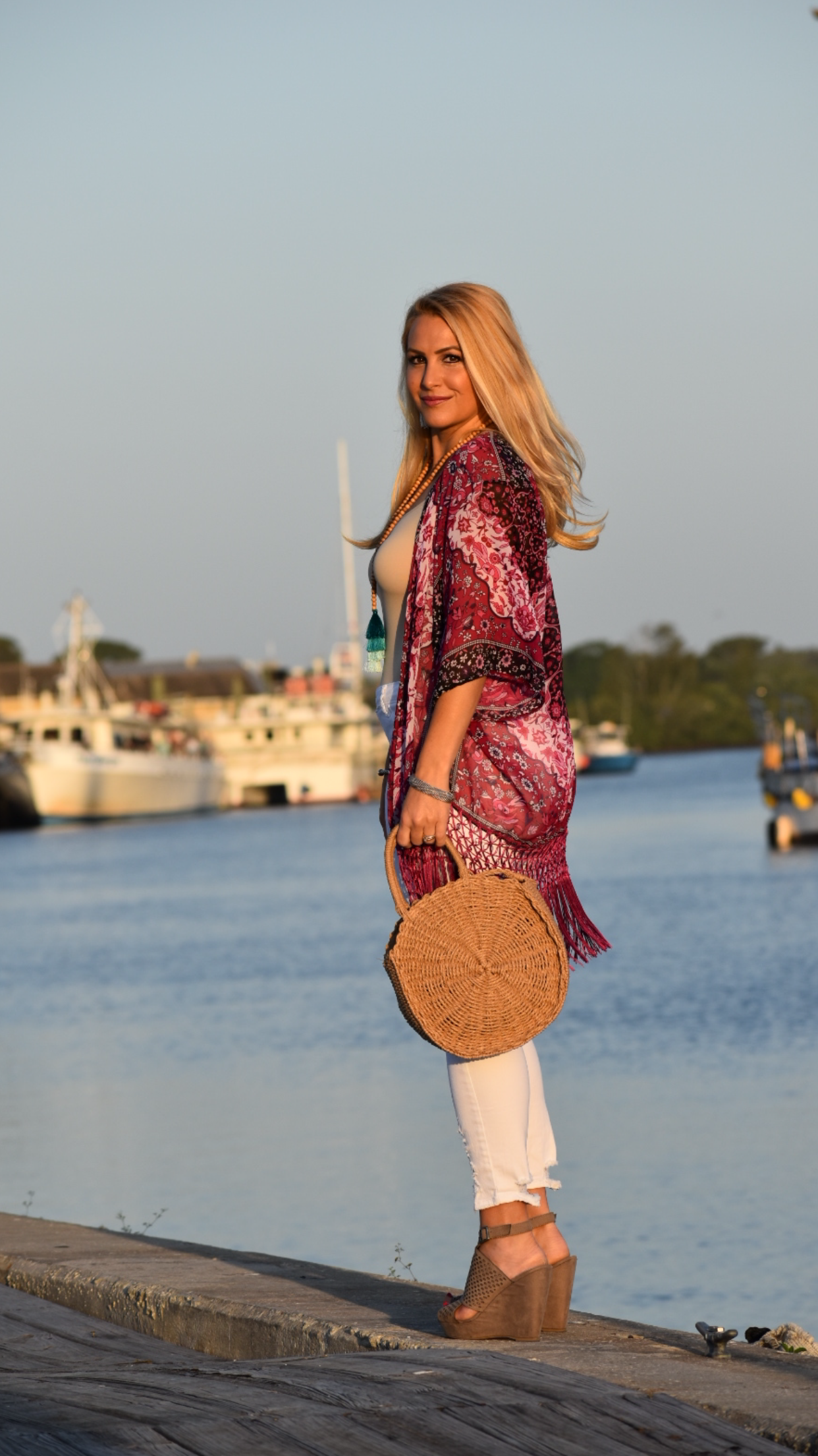 Beach Kimono, White Distressed Jeans, Tassel Necklace and Round Straw Handbag in Tarpon Springs Florida
