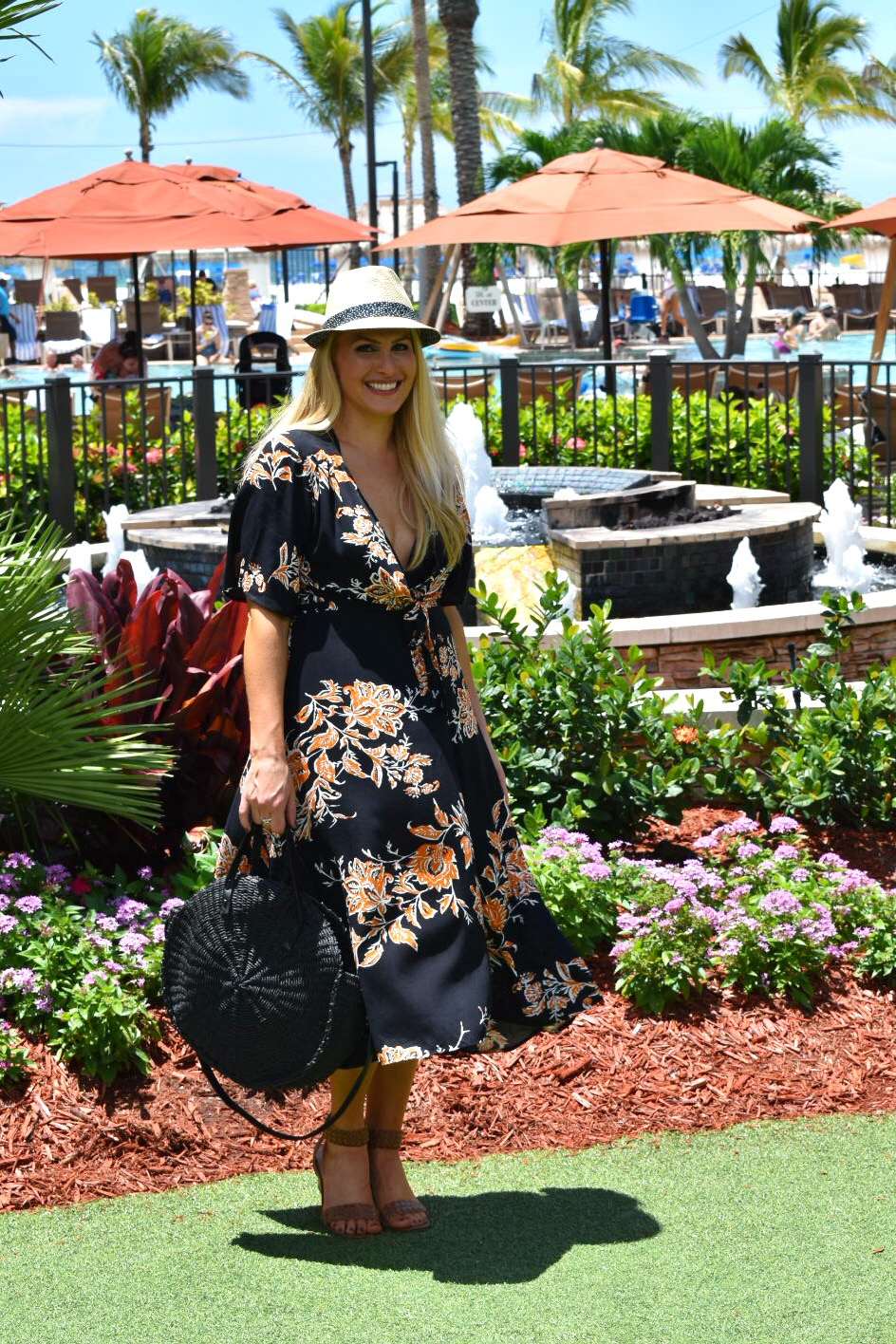 Floral Wrap Dress, Fedora and Round Straw Bag in Marco Island Florida