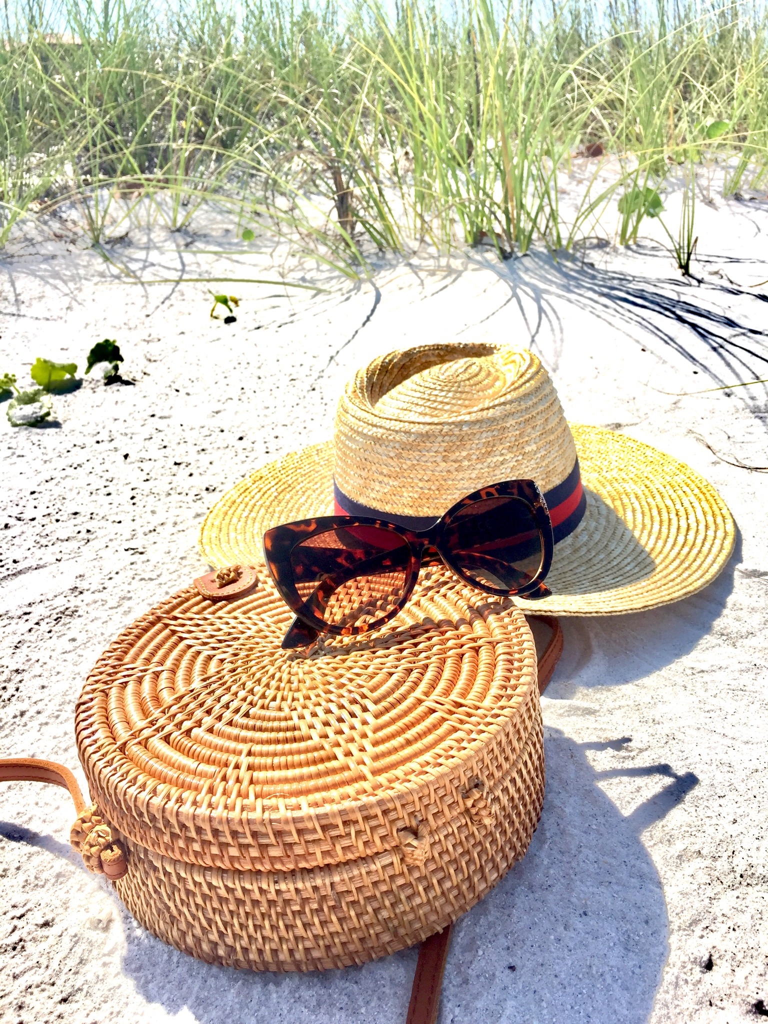 Rattan bag, round bag, straw bag, Cat eye sunglasses, panama hat, fedora