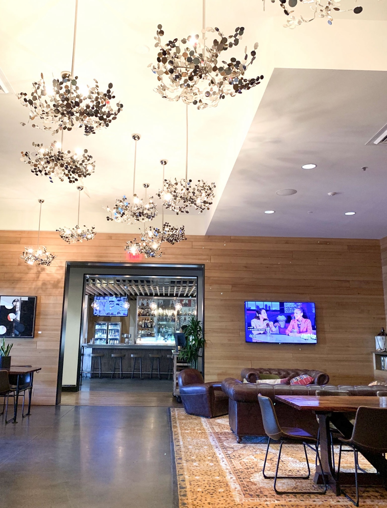 The lobby lounge and chandeliers at the Epicurean Hotel, Autograph Collection 1207 S Howard Ave, Tampa, FL 33606