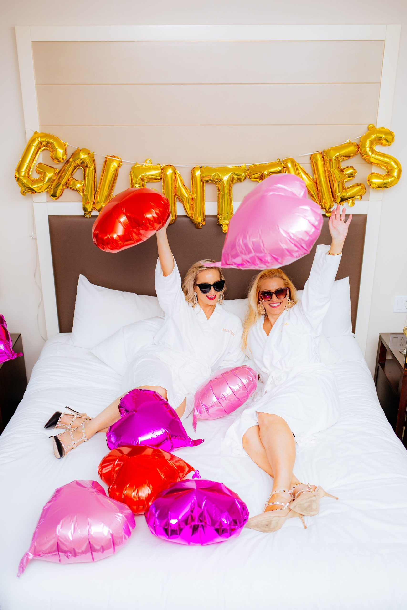 Tampa Fashion Bloggers Jenn Truman @jtstjtst11 and Jill DiGioia @thelovelyflamingo at the Epicurean Hotel, Autograph Collection in their room in white robes and studded high heels